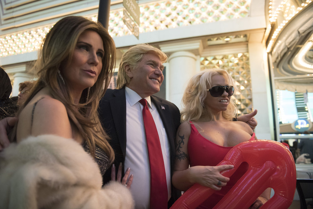 Donald Trump impersonator Marcel Forestieri, center, Melania Trump impersonator Mycki Manning, left, and Pamela Anderson impersonator Ana Lopez hang out on the red carpet prior to The Reel Awards at the Golden Nugget Hotel & Casino in Las Vegas, Nev., on February 20, 2017. The awards show is meant to be a humorous tribute to the Academy Awards. (Jason Ogulnik/Sipa USA)