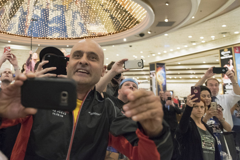 Fans take photos as boxers Andre Ward and Sergey Kovalev arrive at the MGM Grand hotel-casino in Las Vegas, Nov. 15, 2016. The boxers will fight for the Unified Light Heavyweight World Championship title on Nov. 19 at T-Mobile Arena.