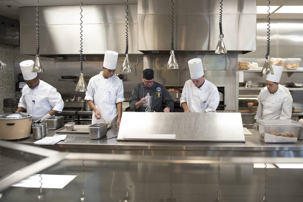 Instructor Jeff Wallace, center, helps students prepare to open for lunch at Westside Bistro at the Culinary Academy of Las Vegas, Nev., Dec. 21, 2016. Jason Ogulnik for Parts Unknown, CNN