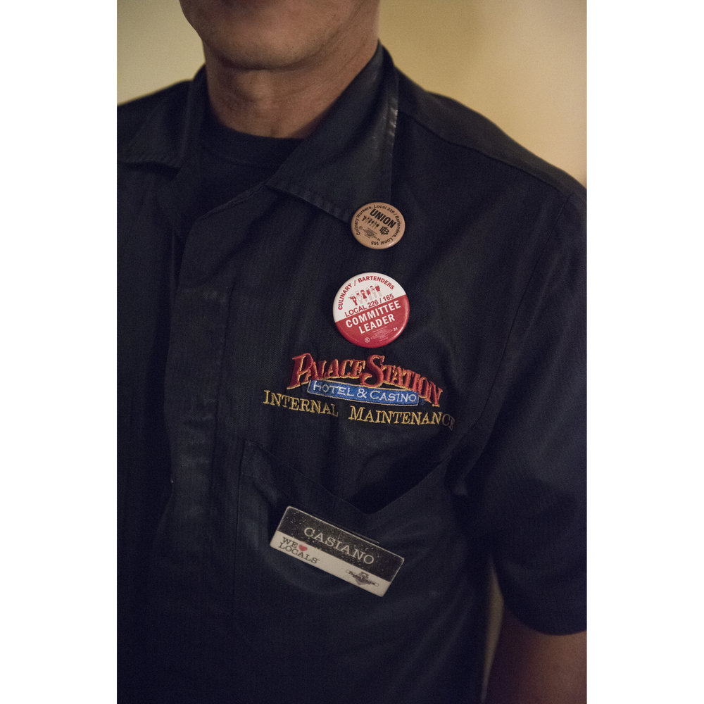 At his Las Vegas home, Casiano Corpus Jr., a non-union porter at Palace Station Hotel & Casino, shows the pro-union buttons on his uniform before leaving to work a graveyard shift, Wednesday, Dec. 21, 2016. Corpus is a union committee leader, advocating for the hotel to allow a union to be formed. Jason Ogulnik for Parts Unknown, CNN