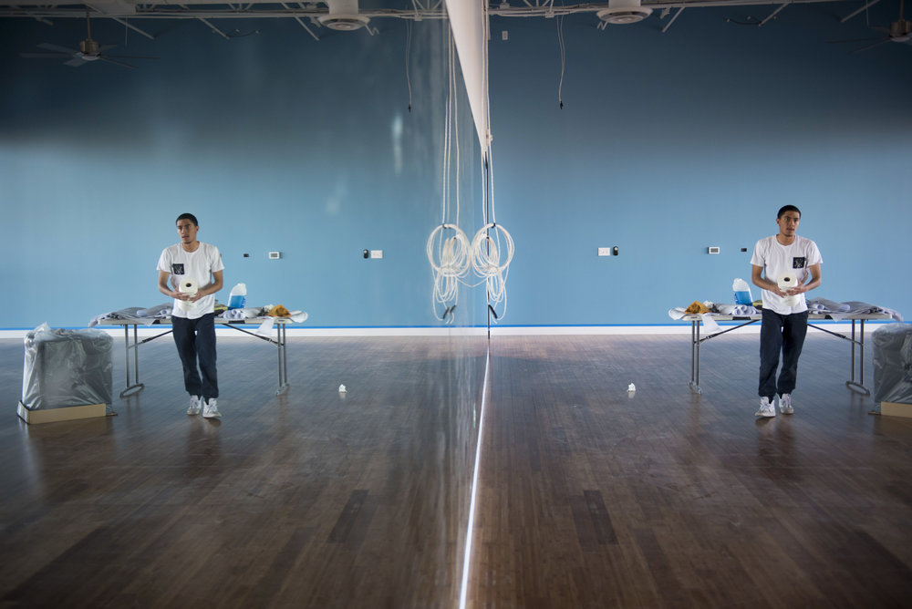Eric Gutierrez cleans the mirrors in the studio of the soon to be opened Evolution Yoga in Henderson, Nev., Feb. 1, 2016.