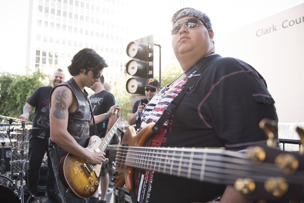 Juan Plascencia, right, of Honor Amongst Thieves and Chris Iorio of Core warm up before playing a set at Las Rageous music festival in Las Vegas, Nev., April 22, 2017.