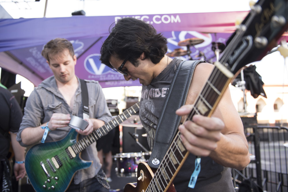 Chris Iorio, right, of Core and Adams Edwards of Honor Amongst Thieves warm up before playing a set at Las Rageous music festival in Las Vegas, Nev., April 22, 2017.
