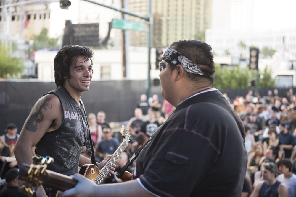 Chris Iorio, left, of Core and Juan Plascencia of Honor Amongst Thieves perform at Las Rageous music festival in Las Vegas, Nev., April 22, 2017.