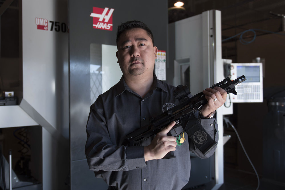 George Huang, president and CEO of Battle Arms Development, holds a rifle in the manufacturing center in Henderson, Nev..