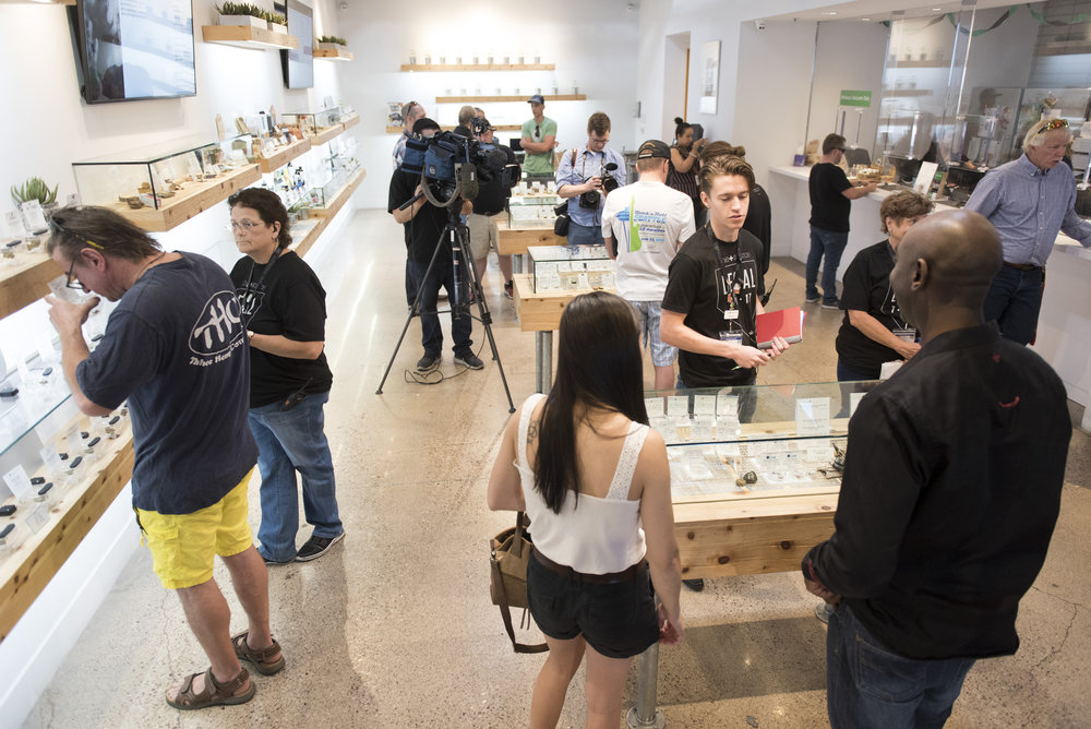 In Las Vegas, Nev. on July 1, 2017, customers shop at The Source marijuana dispensary during the first day of the state's recreational marijuana sales. State residents and visitors over the age of 21 are able to purchase up to one ounce of marijuana flower and 1/8 ounce of concentrate.