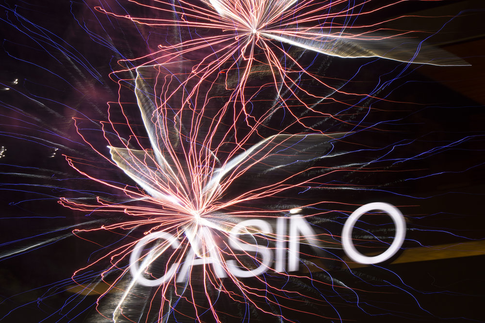 In this double exposure photo fireworks are set off at Red Rock Casino, Resort & Spa in Las Vegas, Nev. on July 4, 2017.