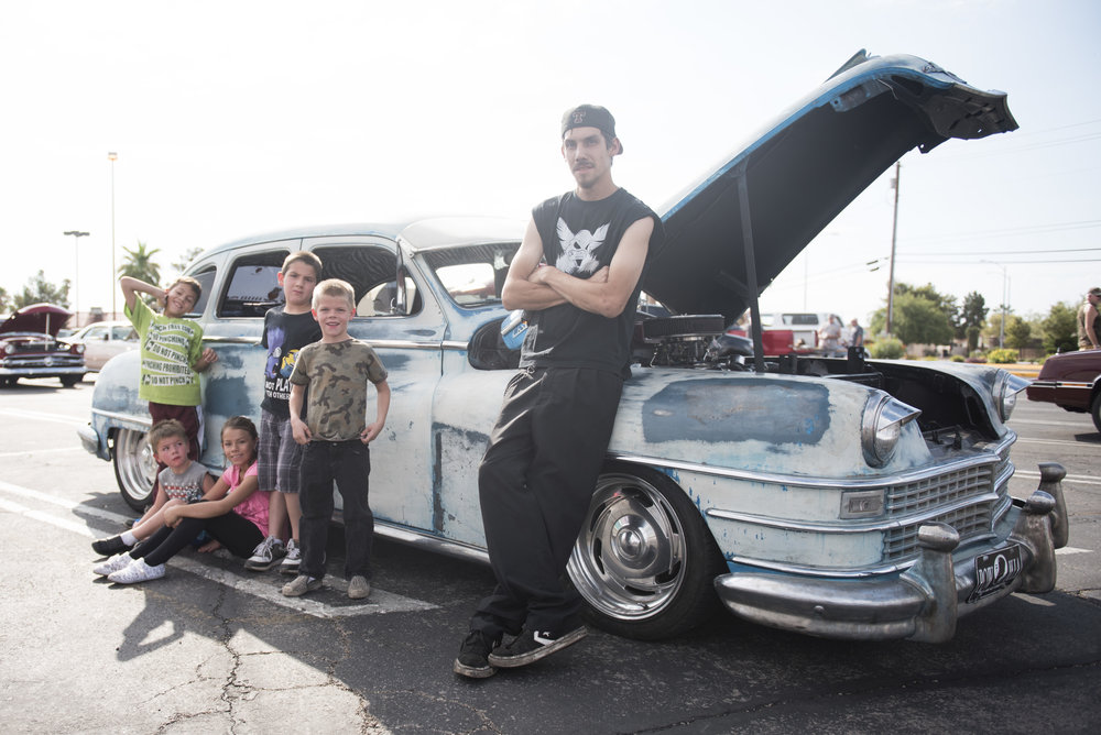Robert Sewell and his children pose for a photo with his Chrysler Windsor at the West End Boys car gathering in Las Vegas, Nev..