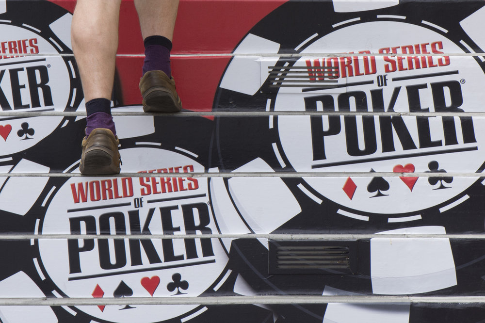 A man walks upstairs towards the World Series of Poker entrance during the tournament at Rio All Suite Hotel & Casino in Las Vegas, Nev..