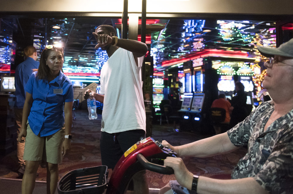 A tourist and a hotel worker talk outside of Casino Royale in Las Vegas, Nev., June 14, 2017.