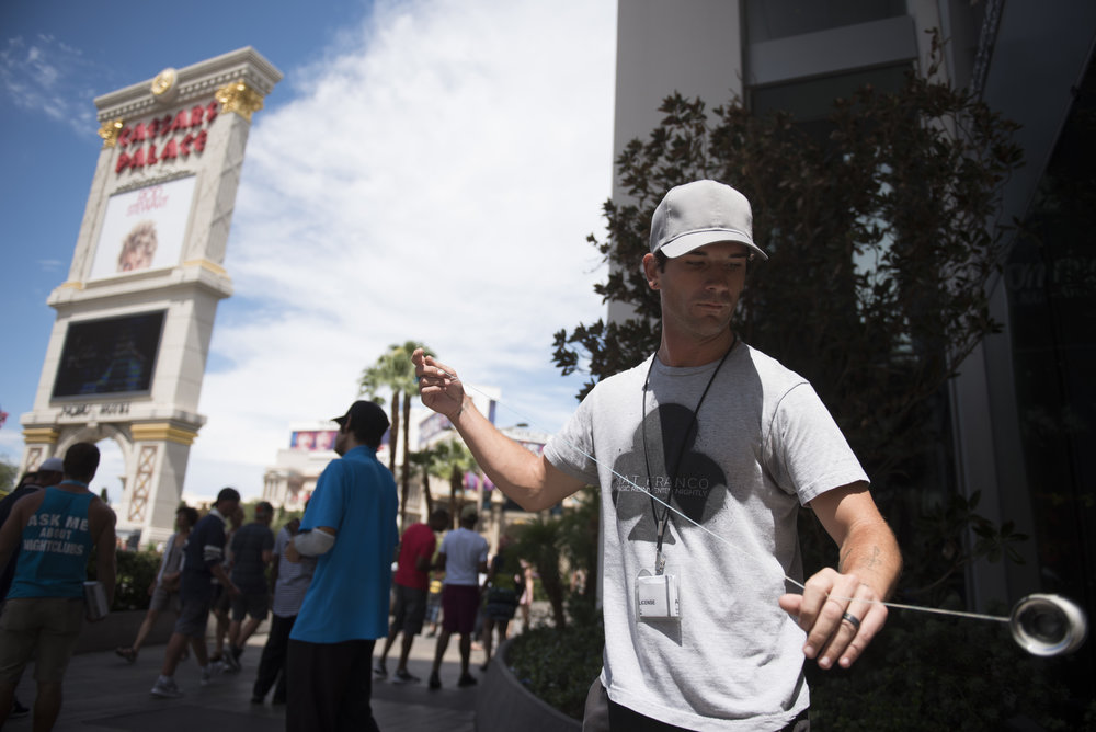 A man plays with a yo-yo at The Linq Promenade in Las Vegas, Nev., Aug. 21, 2017.