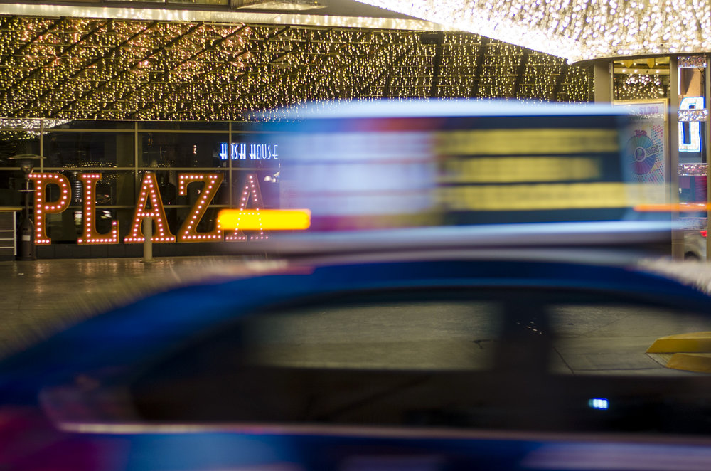 A taxi passes the Plaza hotel and casino in downtown Las Vegas, Nev..