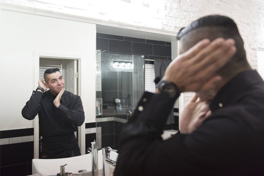 At his Las Vegas home, Ariel Peralta, a server at L'Atelier de Joël Robuchon, applies a facial moisturizer before leaving to work a shift at the restaurant.