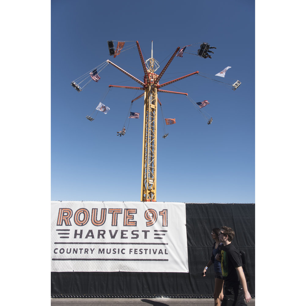 Festival goers arrive at Route 91 Harvest Country Music Festival at MGM Resorts Village in Las Vegas Friday, Oct. 2, 2015.