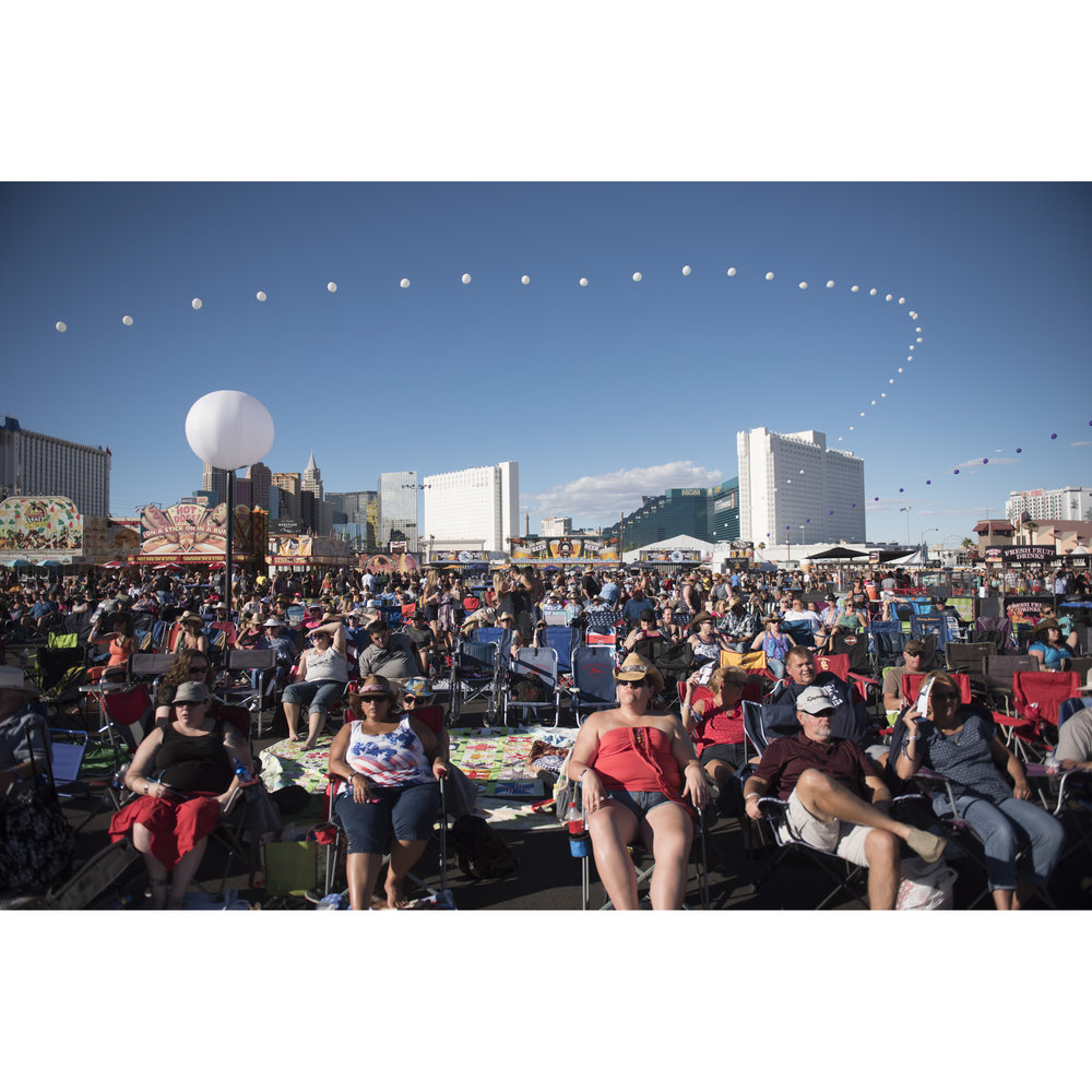 Route 91 Harvest Country Music Festival audience members watch the show at MGM Resorts Village in Las Vegas Friday, Oct. 2, 2015.