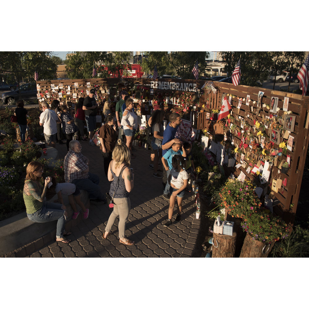 Visitors walk the newly opened Las Vegas Community Healing Garden to commemorate the victims of the Route 91 Harvest Country Music Festival mass shooting in downtown Las Vegas, Nev., Oct. 7, 2017.