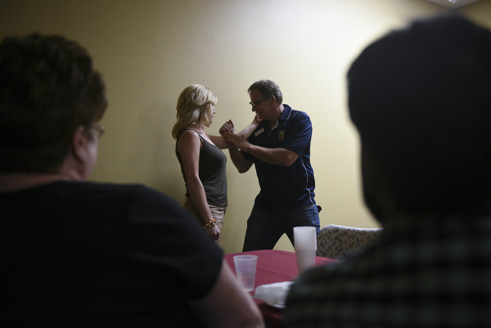 Bob Diamant, a Shaolin Kempo instructor with United Studios of Self Defense, right, demonstrates self defense techniques on Gabby Acton, a group leader at the monthly multiple sclerosis support group at HealthSouth Rehabilitation Hospital in Las Vegas, Nev..