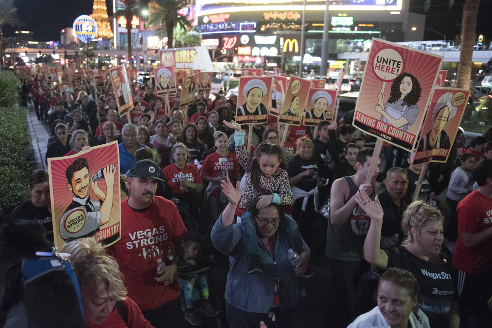 Vegas Strong march attendees walk along the Strip from Caesars Palace hotel-casino to New York New York hotel-casino in Las Vegas on Nov. 9, 2017. The march was organized by Culinary Union Local 226 to support the victims of the Oct. 1 Route 91 Harvest music festival mass shooting.