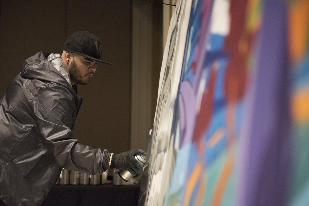 Graffiti artist Tewsr paints a piece during a American Society of Concrete Contractors event at Westgate hotel-casino in Las Vegas, Nev., Jan. 22, 2018.