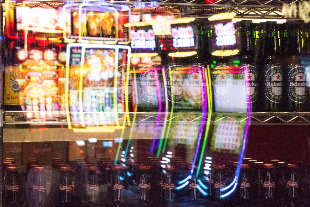 Slot machines are reflected on a window display of beer bottles at SLS hotel-casino in Las Vegas, May 12, 2018.