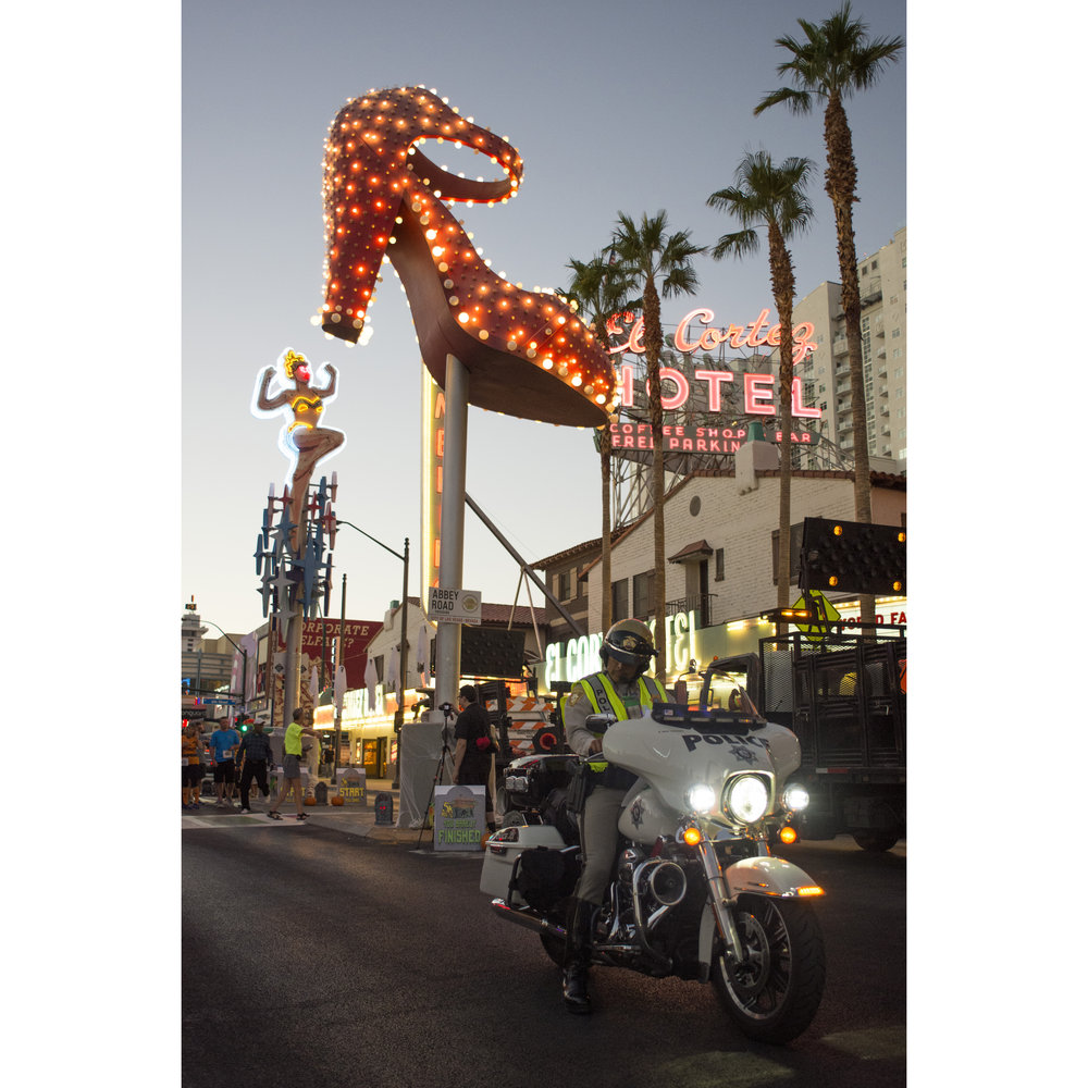 A Las Vegas police officer rides down Fremont Street at 7th Street in downtown Las Vegas.