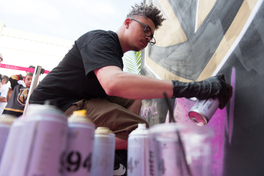 Artist Spen.1 paints a Golden Knights themed mural during a Stanley Cup game 3 watch party at T-Mobile Arena in Las Vegas, June 2, 2018. The mural features hundreds of names of fans. The Golden Knights lost the game to the Washington Capitals 3-1.