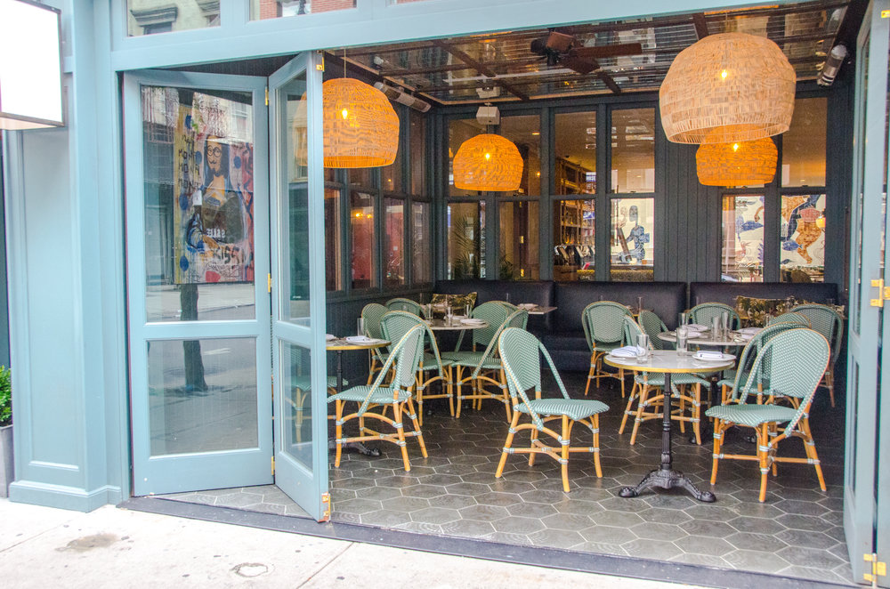 The storefront at the Hotel on Rivington features a custom bi-folding door system.