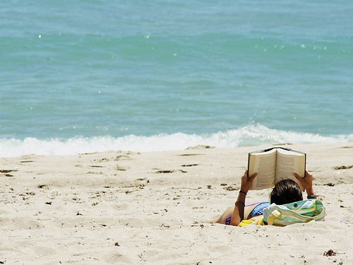 Image via Pinterest  - Pretty much the exact opposite of how I spend my beach days.