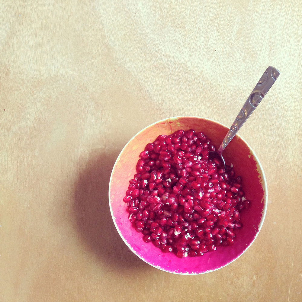 A bowl of pomegranate seeds- full of juicy flavor. Kind of tart, but so delicious and fun to eat.