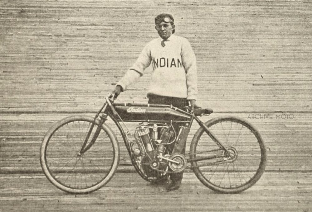 "Nineteen year old W.E. Hasha, aka Eddie, aka, ""The Texas Cyclone"" inside the Springfield Stadium Motordrome earlier in 1911 before he traveled south to race in Birmingham against Stubbs, Mitchell, Balke, and DeRosier later fall. The machine he is standing with is the one that he most likely competed on for the events at the Alabama State Fairgrounds as he acquired his monstrous and elegant 8-Valve shortly after that event, just before the start of the 1912 season in Los Angeles."