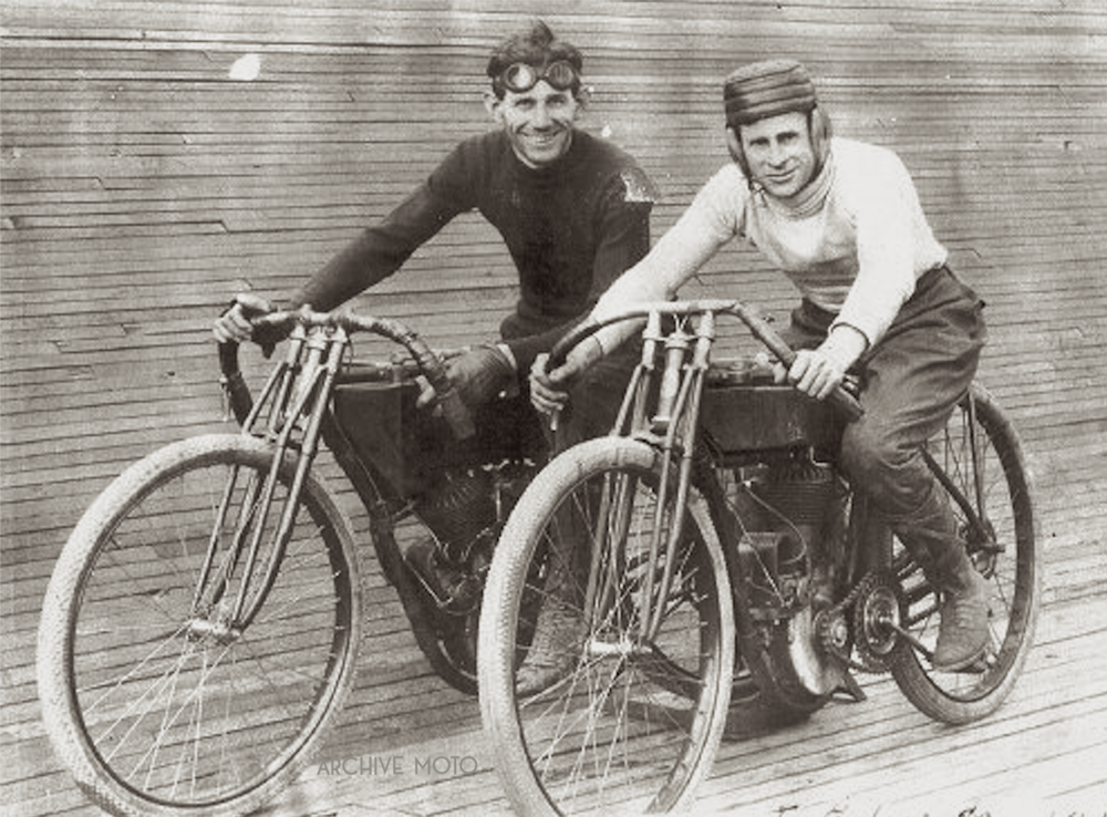 Seen here is 23 year old ginger speedster Erle Armstrong onboard his frequently victorious yellow Flying Merkel twin. The photograph was taken during Armstrong's winning streak at the Tuileries motordrome in the summer of 1911. Posing beside Armstrong is his friend and fellow local Merkel competitor Cort Edwards with his ever-so protective Wilson flattop football helmet.