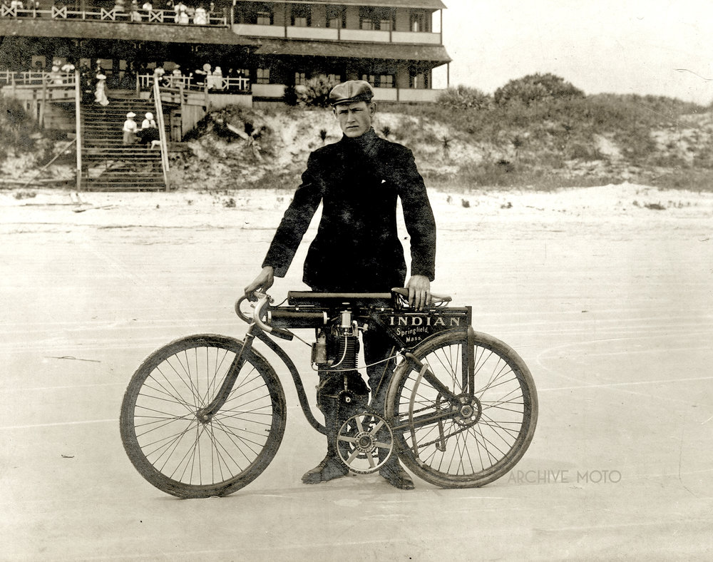 Oscar Hedstrom with his prototype racer, what may have been the very first Indian factory racing motorcycle, in front of the Ormond Hotel in late March, 1903