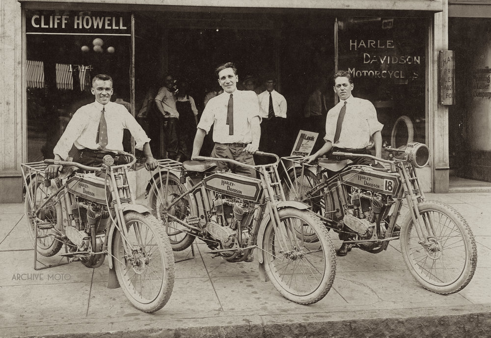 Photographed here are John D. Aikens, William F. Specht, and Gray Sloop in front of Specht's new Harley-Davidson dealership in downtown Birmingham, AL in July 1914.