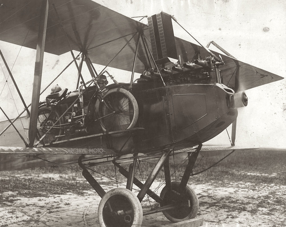 Here, with the prop spinning and the brand new Indian Model O light weight twin strapped tight between the wings is John E. Hogg (front) and Eric E. Springer (rear) onboard a U.S. Navy Wright-Martin Model R reconnaissance biplane for a test flight in Inglewood, Ca, March 30, 1917.