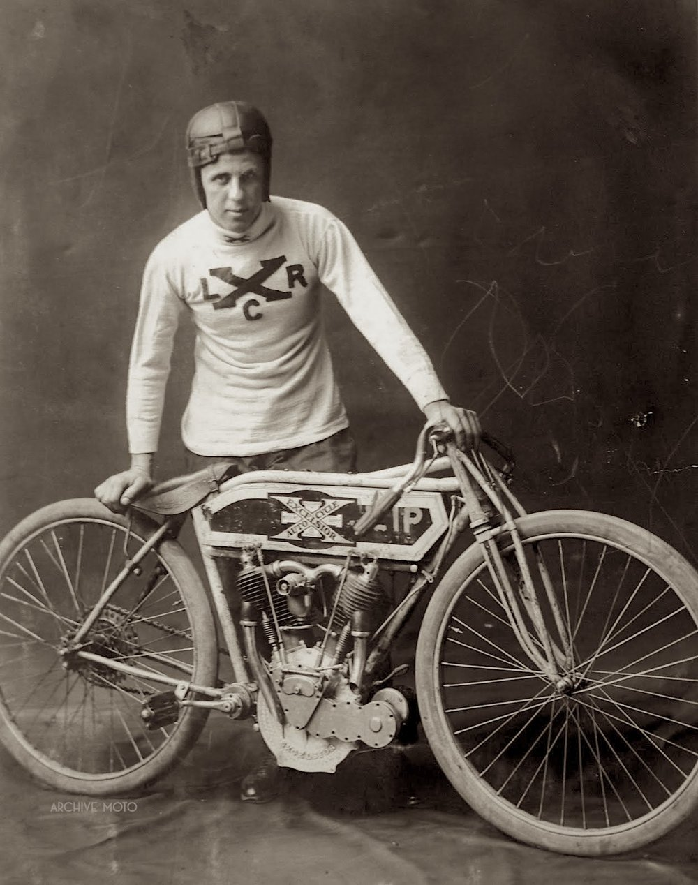 For decades credited as an unknown Excelsior racer, here is Curley Fredericks in the early days of his lengthy professional racing career posing with an Excelsior 7 ca. 1913.