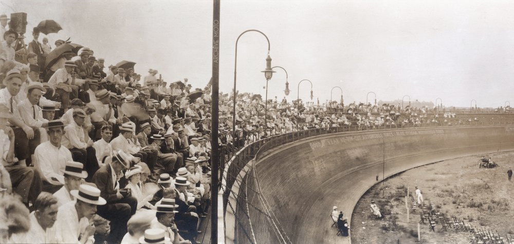 An intimate glimpse inside the St. Louis Motordrome during the national Ballon Race, launched from the infield of the massive 1/4 mile motorcycle board track on Jully 11, 1914.