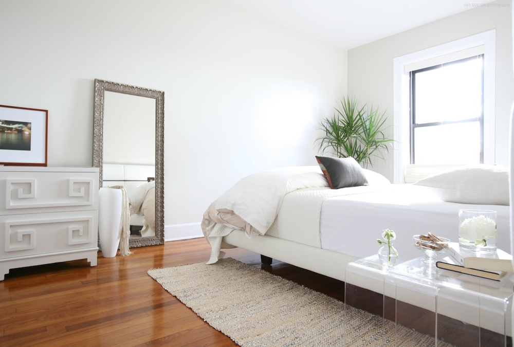 """Brooklyn interior design project: master bedroom decor.  All white interior."""