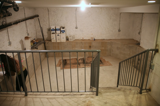 "On the landing/cellar ""foyer"" looking into sunken area."