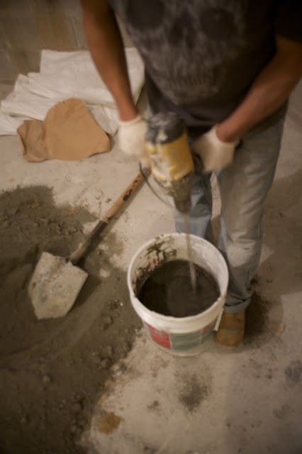 Mixing concrete on-site. Photos by Niya Bascom Photography, all rights reserved.