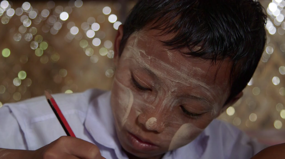 A boy in Myanmar studying in a school built by Helping the Burmese Delta