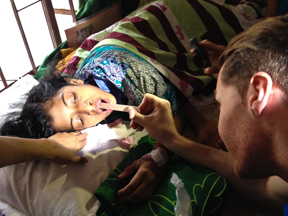 Dr. Sami Nizam examining one of the patients after surgery.