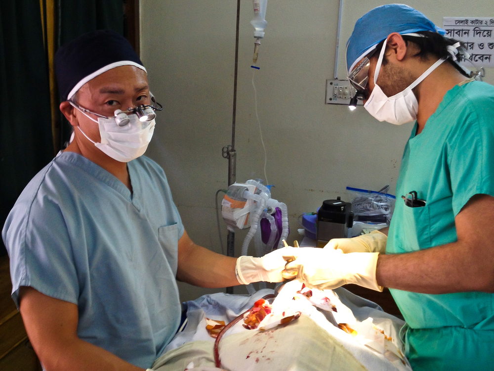 Here I am operating with Dr. Imran Ahson