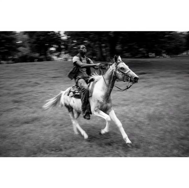 Howdy! My name is Charles Mostoller (@charlesmostoller) and I was an attendee at this year's #lookbetween gathering in June. Over the next week, I'll be showing some images from an ongoing project I began recently on a group of teenage African-American horseback riders in Southwest Philadelphia. In this image, Shahir Drayton rides his pony Storm through a park in West Philly.