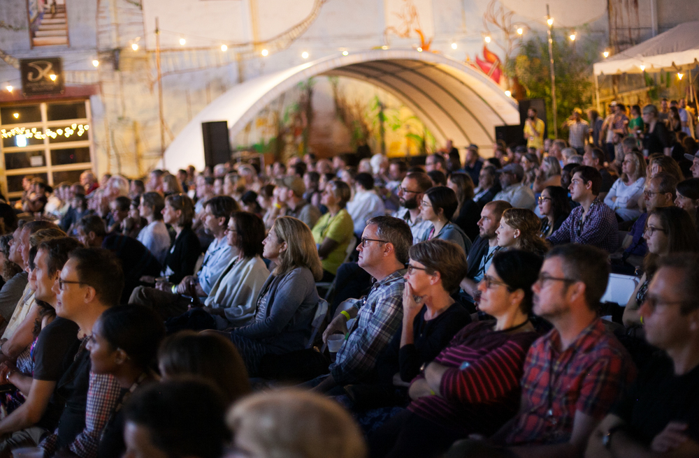Attendees watch the Saturday evening projectsions at the IX Art Park. Photo © Tom Daly