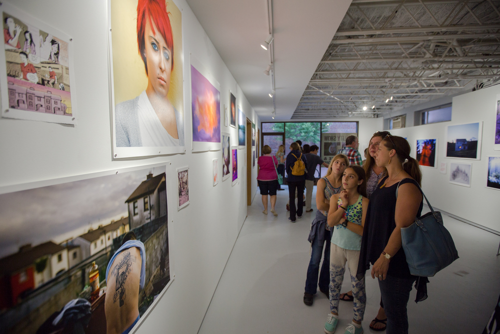 Festival Attendees in Olivia Bee & Doug DuBois' exhibition space during the Toast the Artist Gallery Walk.