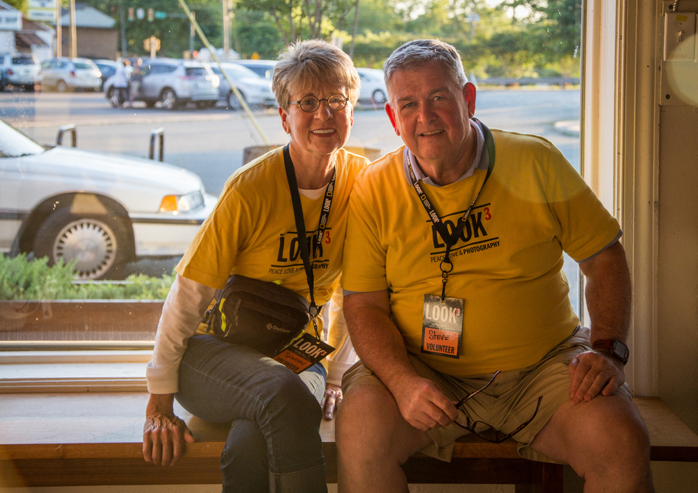 Two of our incredible volunteers take a break at the Ruddy Roye Exhibit. Photo © Oana Moore