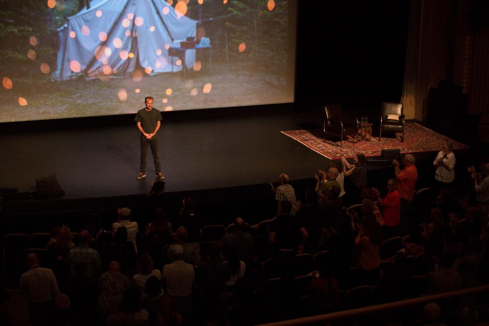 Joe Riis on stage at the Paramount Theater. Photo © Jon Golden
