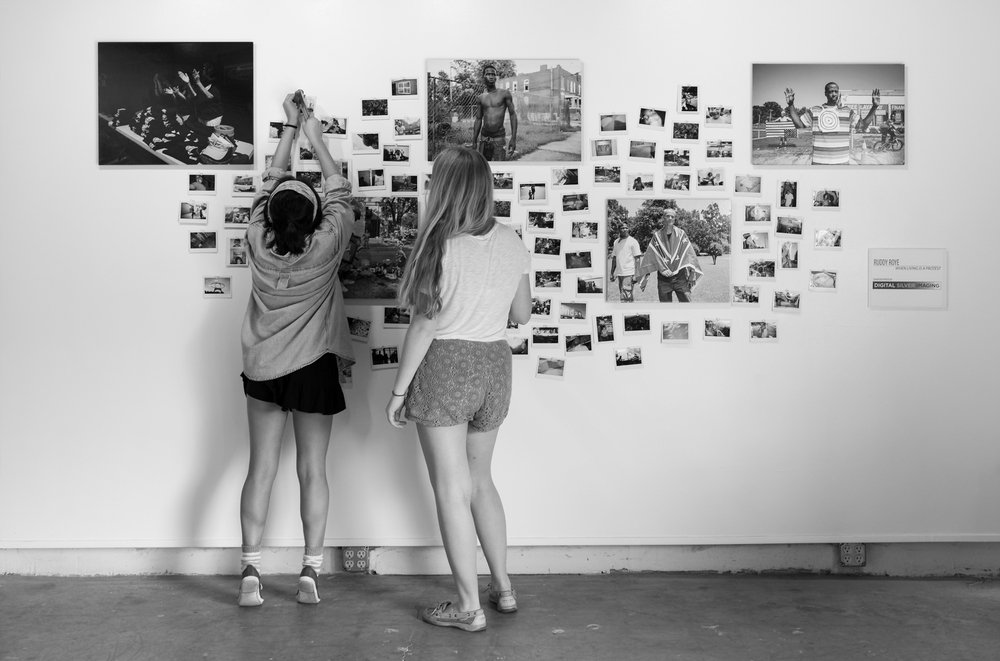 Ruddy Roye's workshop students hang their polaroids up on one of the walls in Roye's exhibition space.  Photo © Keith Alan Sprouse