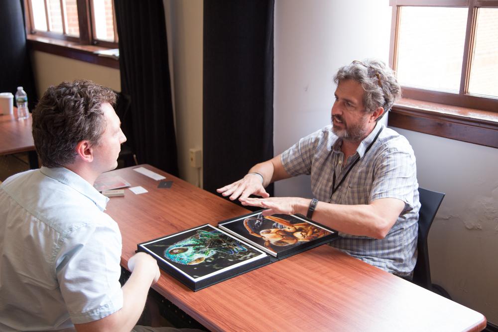 Photographer Daniel Kariko and Gordon Stettinius, Owner, Candela Books & Gallery meet at LOOK3 PITCH Portfolio Reviews during LOOK3 EDU   Photo © Jon Golden