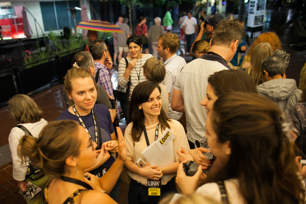 LOOK3 employees gather outside of the Paramount Theater after an artist talk.  Photo © Tom Daly